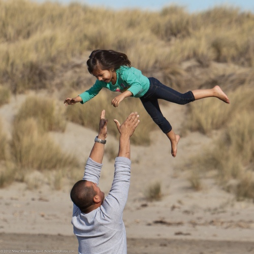 Father Tossing Daughter